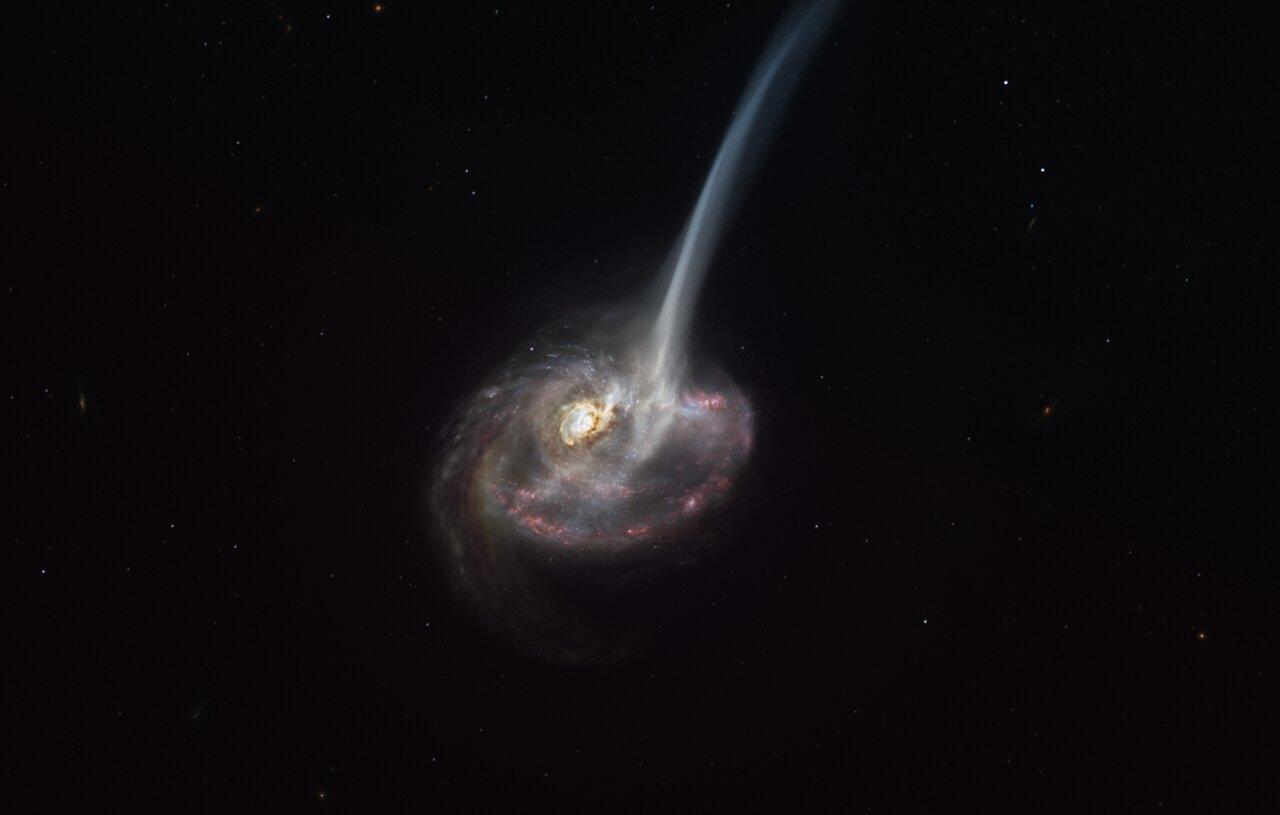 """Un render della galassia IS2299 mentre espelle il gas dalla """"coda marcale"""", risultata da una fusione con una precedente galassia. Credits: ESO/M. Kornmesser"""